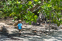 Two year old boy walking on the beach at Boca del Drago, near Star Beach, Colon Island, Panama