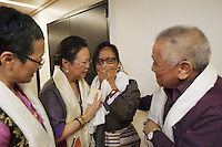 Switzerland. Basel. St. Jakobshalle. Dolma Knell (L), Yangchen Büchli (CL), Dicki Shitsetsang (CR) and Rinzin Lang (R) are moved by emotions after their personal meeting with His Holiness the 14th Dalai Lama. The three women and the man are part of Aeschimann's children who arrived 50 years ago in Switzerland to receive custody on a private initiative by an influential Swiss industrialist, Charles Aeschimann. In 1962, Charles Aeschimann agreed with the Dalai Lama to take 200 children and place them in Swiss foster homes and give them a chance for a better life and a good education. Most of the children still had parents in exile or in Tibet, just a few were orphans. 8.02.2015 © 2015 Didier Ruef