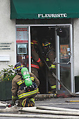Joliette firemen at scene of a flower shop fire