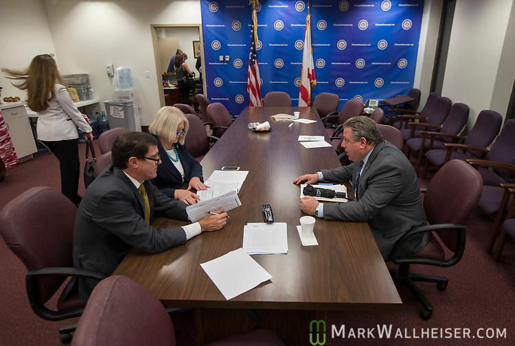 David Daniel, left, a lobbyist with Smith, Bryan & Myers, talks with Sen. Linda Stewart, D-Orlando, confer after the Democratic Caucus meeting in the Senate office building at the Florida Capitol in Tallahassee, Florida.