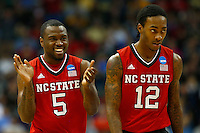 PITTSBURGH, PA - MARCH 21: Desmond Lee #5 and Anthony Barber #12 of the North Carolina State Wolfpack celebrate in the first half against the Villanova Wildcats during the third round of the 2015 NCAA Men's Basketball Tournament at Consol Energy Center on March 21, 2015 in Pittsburgh, Pennsylvania.  (Photo by Jared Wickerham/Getty Images)
