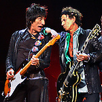 Ron Wood, left, and Keith Richards, right, during the Rolling Stones concert, Thursday night at the Staples center in Los Angeles.