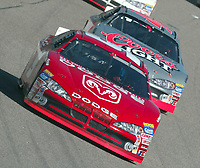 Bill Elliott leads Sterling marlin enroute to victory in the Pop Secret 400 NASCAR Winston Cup race at Rockingham, NC on Sunday, November 9, 2003. (Photo by Brian Cleary)