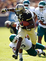 WEST LAFAYETTE, IN - SEPTEMBER 15:  Running back Akeem Shavers #24 of the Purdue Boilermakers runs away from defensive back Donald Coleman #3 of the Eastern Michigan Eagles to score a touchdown at Ross-Ade Stadium on September 15, 2012 in West Lafayette, Indiana. (Photo by Michael Hickey/Getty Images)***Local Caption***Akeem Shavers; Donald Coleman