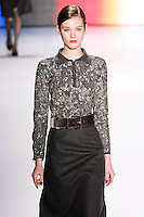 Jac walks runway in an outfit from the Carolina Herrera Fall 2011 collection, during Mercedes-Benz Fashion Week Fall 2011.