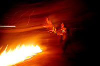 Police clash with stone throwing youth following the arrest of separatist leaderMuhammad Yaseen Malik. A young man puts more wood on a burning barricade. Srinagar, Kashmir, India.  Fredrik Naumann/Felix Features