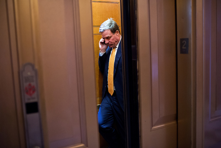 UNITED STATES - SEPTEMBER 9: Sen. Mark Warner, D-Va., talks on the phone after the senate luncheons in the Capitol, September 9, 2014. (Photo By Tom Williams/CQ Roll Call)