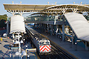 A high angle view of commuters boarding a southbound Caltrain train at the Millbrae Transit Hub in the morning. The Hub consists of Caltrain, BART, bus stops, and parking garage. Millbrae, California, USA