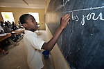 A boy writes on the blackboard during a class in the Bahadon Second Cycle School in Timbuktu, a city in northern Mali which was seized by Islamist fighters in 2012 and then liberated by French and Malian soldiers in early 2013. The jihadis first banned all schools, then under pressure from the community, allowed them to open but with separate classes for boys and girls.