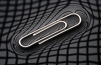 PAPER CLIP FLOATING ON WATER<br /> Demonstrates Surface Tension<br /> The paper clip depresses the water surface and is balanced by the surface tension forces on either side which are parallel to the water's surface at the points where it contacts the paper clip. A pattern is projected onto the surface of the water.