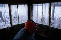 Donovan Nokes sits in a hunting blind and waits for deer on Monday, December 5, 2011 in Webster City, IA.