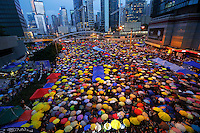 Protesters open their umbrellas, symbols of pro-democracy movement as they mark exactly one month since they took the streets in Hong Kong's financial central district October 28, 2014. Hong Kong has been roiled by a tenacious, month-long student-led people's movement demanding full democracy in the former British colony that returned to Chinese rule in 1997. REUTERS/Damir Sagolj (CHINA)