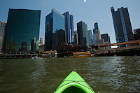 My kayak points toward the Chicago skyline with the Sears Tower toward the right at the meeting of the north and south branch of the Chicago River.