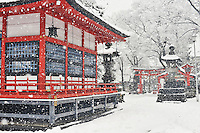 During a winter snowfall, the Fukashi Shrine looks like a traditional Japanese woodblock print. Matsumoto, Nagano, Japan.<br /> <br /> (title translation by Stephen Addiss)