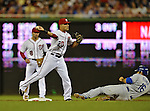 20 September 2012: Washington Nationals shortstop Ian Desmond doubles off a sliding Andre Ethier during a game against the Los Angeles Dodgers at Nationals Park in Washington, DC. The Nationals defeated the Dodgers 4-1, clinching a playoff birth: the first time for a Washington franchise since 1933. Mandatory Credit: Ed Wolfstein Photo