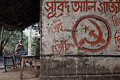 The Communist party signs are seen on the wall of a tea-shop in a Chaymalpur village of North 24 Parganas in West Bengal, India. Photo: Sanjit Das/Panos for The Wall Street Journal. Slug: ICASTE