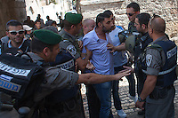 A Palestinian argues with the police at the entrance to temple mount in the old city of Jerusalem on September 13, 2013. Israeli police declared an age limit on Friday for Palestinians wanting to enter the Old City, only allowing males above the age of 45 and all females to enter, as Yom Kippur, the Jewish day of atonement, begins at sundown. Photo by Oren Nahshon