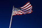 American Flag, Stars and Stripes, waving in the wind with blue sky, Lynnwood, Washington USA