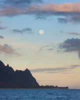 The full moon sets at sunrise over Mt. Makana (Bali Hai) on Kauai.