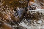 Water flowing over the reddish rocks in Myrtle Creek