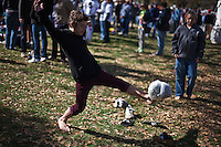 Boys play soccer with a make-shift ball at the Rally to Restore Sanity and/or Fear on the National Mall in Washington, D.C. on Saturday, October 30th, 2010...(Samuel Corum for TBD)