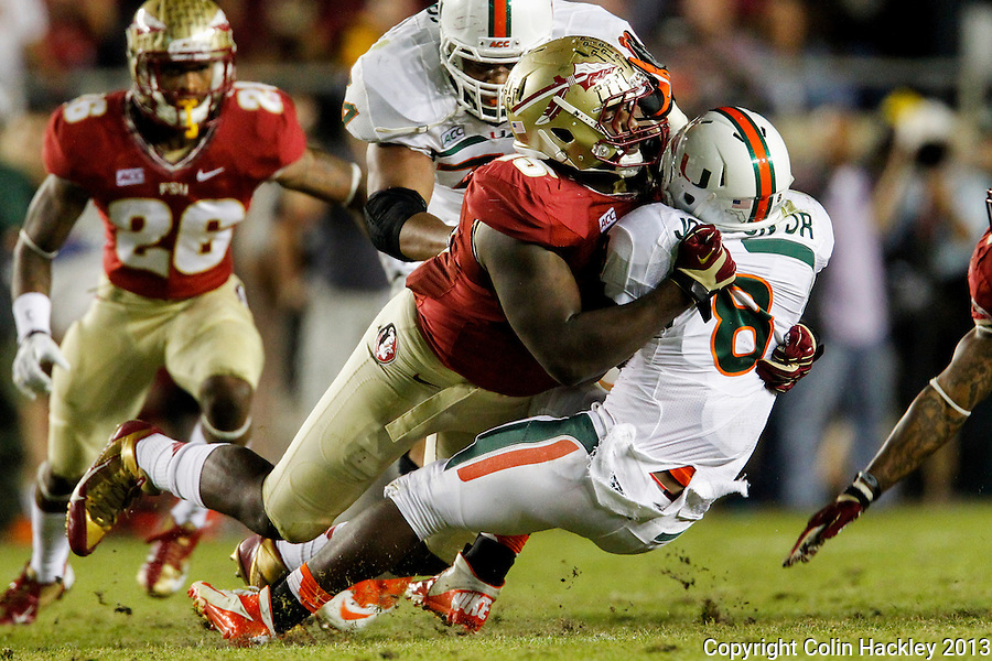 TALLAHASSEE, FL 11/2/13-FSU-MIAMI110213CH-Florida State's Mario Edwards, Jr. flattens Miami's Duke Johnson during first half action Saturday at Doak Campbell Stadium in Tallahassee. <br /> COLIN HACKLEY PHOTO