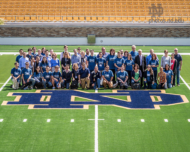 Aug. 15, 2014; 2014 New Faculty pose for a group photo in Notre Dame Stadium.<br /> <br /> Photo by Matt Cashore/University of Notre Dame