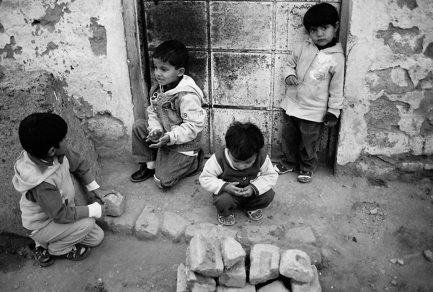 Children play in one of the alleys of the French colony slum. Islamabad