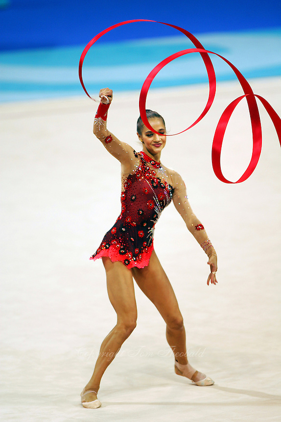 Irina Tchachina of Russia waves circles with ribbon at 2004 Athens Olympic Games during qualifying round on August 27, 2006 at Athens, Greece. Irina won silver in the All-Around final. (Photo by Tom Theobald)