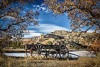 An old wagon sits beneath winter dormant Cottonwoods at Ghost Ranch near Abiquiu, New Mexico