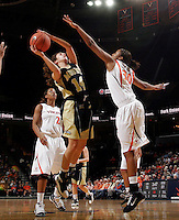 Nov. 14, 2010; Charlottesville, VA, USA;  Mount St. Mary's guard Ashley Christie (14) shoots between Virginia forward Telia McCall (30) and Virginia guard Whitny Edwards (2) during the game at the John Paul Jones Arena. Virginia won 81-58. Mandatory Credit: Andrew Shurtleff