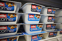 Containers of Müller greek style and traditional yogurt are seen on a supermarket shelf in New York on Sunday, August 26, 2012. Theo Müller and PepsiCo have a joint venture to bring the German Müller brand yogurt to the United States under the Müller Quaker Dairy brand. PepsiCo owns Quaker Foods. Greek style yogurt has become popular in the last few years with several companies opening up manufacturing plants in upstate New York. While initially imported from German the companies have invested in a plant upstate New York. (© Richard B. Levine)