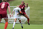 03 November 2010: Virginia Tech's Jazmine Reeves (5) clears the ball away from UNC's Kelly McFarlane (11). The University of North Carolina Tar Heels defeated the Virginia Tech Hokies 4-2 at Koka Booth Stadium at WakeMed Soccer Park in Cary, North Carolina in an ACC Women's Soccer Tournament Quarterfinal game.
