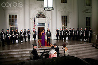 13 Oct 2011, Washington, DC, USA --- President Barack Obama and first lady Michelle Obama wait to greet South Korean President Lee Myung-bak and his wife Kim Yoon-ok on the North Portico of the White House in Washington for a state dinner. --- Image by © Brooks Kraft/Corbis