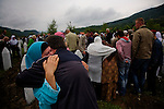 Families of Srebrenica victims gather at the Potocari memorial to bury the remains of their loved ones.