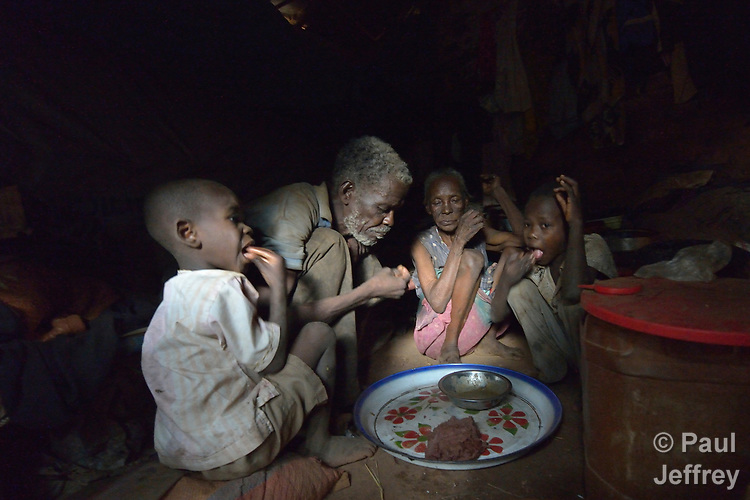 A family shares a meal inside their shelter in a camp for more than 12,000 internally displaced persons located on the grounds of the Roman Catholic Cathedral of St. Mary in Wau, South Sudan. Most of the families here were displaced in June, 2016, when armed conflict engulfed Wau.<br /> <br /> Norwegian Church Aid, a member of the ACT Alliance, has provided relief supplies to the displaced in Wau, and has supported the South Sudan Council of Churches as it has struggled to mediate the conflict in Wau.