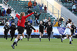 07 November 2010: Players from the Wake Forest bench rush the field towards goalkeeper Aubrey Bledsoe after the penalty kick shootout. The Wake Forest University Demon Deacons defeated the University of Maryland Terrapins 3-1 on penalty kicks after the game ended in a 1-1 tie after overtime at WakeMed Stadium in Cary, North Carolina in the ACC Women's Soccer Tournament championship game.