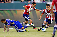 Chivas USA midfielder's Jonathan Bornstein (l) and Paulo Nagamura (r) blow past Kansas City Wizards forward Teal Bunbury. The Kansas City Wizards defeated CD Chivas USA 2-0 at Home Depot Center stadium in Carson, California on Sunday September 19, 2010.