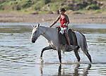 A girl crosses a river on his horse in northwestern Nicaragua.