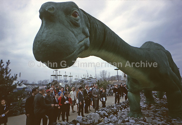 """""""Dinoland,"""" 1964 World's Fair, Flushing Meadows, New York. The Dinosaur exhibit was sponsored by Sinclair Oil and featured life-size, fiberglass replicas of nine different dinosaurs, including Sinclair Oil's signature green Brontosaurus. Photo by John G. Zimmerman."""
