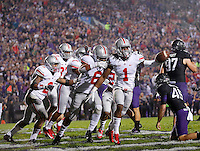 Ohio State Buckeyes cornerback Bradley Roby (1) celebrates with teammates after the blocked punt and touchdown during the first half of the NCAA football game between Ohio State and Northwestern at Ryan Field in Evanston, Illinois on Saturday, October 5, 2013. (Columbus Dispatch photo by Jonathan Quilter)