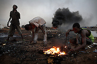 Children burn cables from computers and other electronic equipment in order to retrieve copper, at Agbogbloshie dump, in Accra, Ghana. Combustion releases toxic metals such as lead, beryllium, cadmium and mercury into the atmosphere and at theses burning sites concentrations of toxic metals have been found at over one hundred times the normal level. .