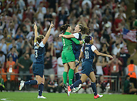 London, England - Thursday, August 9, 2012: The USA defeated Japan 2-1 to win the London 2012 Olympic gold medal at Wembley Stadium. Hope Solo and Lauren Cheney, center, celebrate the USA victories. .