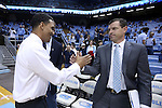 28 December 2016: Former UNC player and current head coach King Rice (left) meets UNC assistant coach C.B. McGrath (right). The University of North Carolina Tar Heels hosted the Monmouth University Hawks at the Dean E. Smith Center in Chapel Hill, North Carolina in a 2016-17 NCAA Division I Men's Basketball game. UNC won the game 102-74.