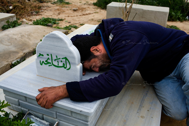 Al Tufa'ah, Gaza Strip, Jan 20 2009.Nadji Hessenin collapses in tears after burying his children Shourouk Nadji Hessenin, 13 and her brother Abdallah, 12 who were killed instantly upon returning to their house in She'Af Tufa'ah by a Hamas planted booby trap destined to israeli soldiers. Hundreds of houses, farms and factories have been destroyed and bulldozed over by the Israeli army, flattening approximately an area 10km square, ruining countless families, left resourceless in what amounts to collective punishment..