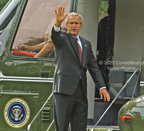 Washington, D.C. - September 11, 2004 --  United States President George W. Bush waves from the steps of Marine One at the White House in Washington, D.C. as he prepares to depart on September 11, 2001.  <br /> Credit: Ron Sachs / CNP