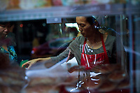 A woman works in a bakery at east lower Manhattan in New York. October 6, 2012. United States economy has gained 114,000 jobs, putting the jobless rate from 8.1 percent to 7.8 percent, first time it's been below 8 percent since 2009.  Photo by Eduardo Munoz Alvarez / VIEW.