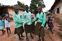 School girls, Newton, Freetown, Sierra Leone. Planting Promise is an organization dedicated to the development of education in Sierra Leone. Its aim is to bring opportunities to initiate self-run, self-supporting projects that offer real solutions to the difficulties facing the world's poorest country. They believe real and lasting development comes from below, from local projects that address specific needs, rather than large international models. To this end, they currently run five projects that aim to bring wealth into the country through business. The profits from these businesses are then used to support free education for children and adults...Through the combination of business with social progress, the charity hopes that they are providing real, lasting and profound changes for the better, by promoting sustainable and beneficial industry in the country, and putting it to the service to the needs of the people. As well as providing the income to fund the school, the farms will also be an example of successful commercial enterprise to teach the children in the school the viability of profit-making schemes that go beyond subsistence models, the only things the children of these desperately poor areas are accustomed to. By learning particular details of the challenges that they will face, the children will emerge from this school equipped to contribute in a real way to their society.