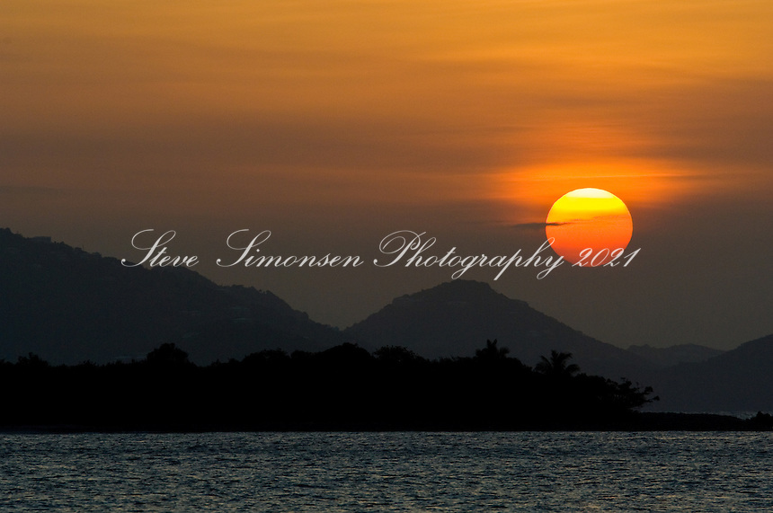 Sunset over St Thomas and Stevens Cay from Frank Bay St John