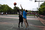 Basketball game in Brownsville with the Broadway Junction A train stop in the background in Brooklyn, NY on June 24, 2012.